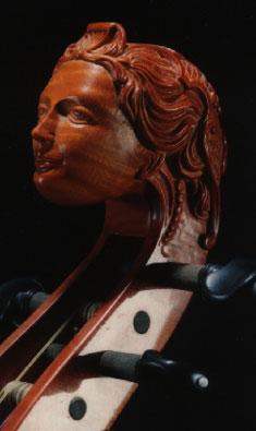 Een vrouwenhoofd als kop van een contrabas.