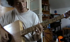A bass made out of a box.