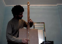 A bass made out of a cardboard box.