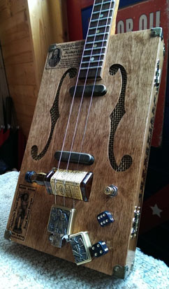 A bass guitar with a slim and flat body and with dice .