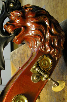 A carved double bass with the head of a lion.