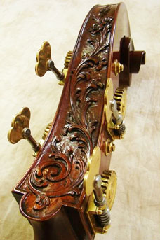 A carved double bass head of flowers.