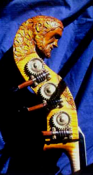 A carved double bass head of a head.