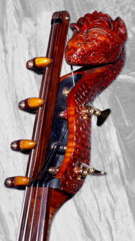 A carved double bass with the head of a dragon.