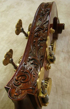 A beautifully carved double bass head with flowers.