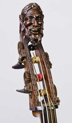 A double bass with a carved head of a bearded man.