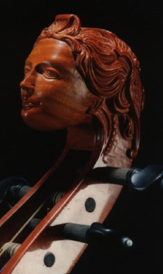 A double bass with a carved head head by Bertrand.