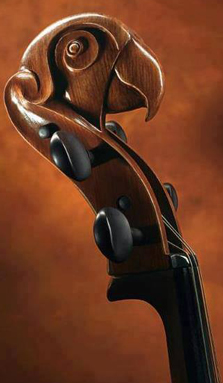 A double bass with the carved head of a bird.