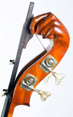 A double bass with a carved head of a hand.