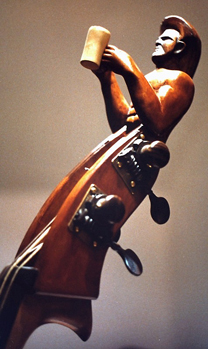 A double bass head of a beer drinker by Gerard Samija.
