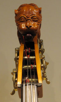 A double bass with a head of a lion.
