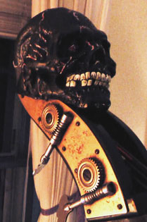A double bass with a head of a skull.