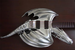 A bass guitar in the form of a dragon.