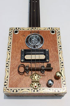 A bass guitar with a drain and a key.