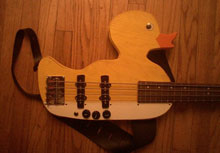 A bass guitar in the form of a duck.
