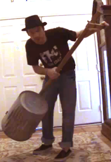 A bass made out of a garbage can.