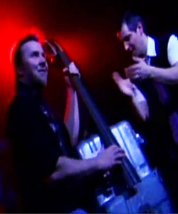 A double bass made out a gas bottle.