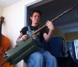 A bass guitar made out of a jerry can.