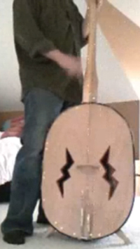 A bass with screws and lightning holes.