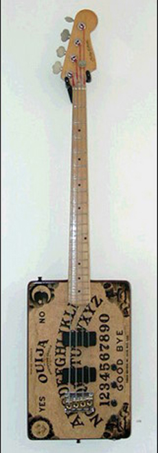 A bass made out of a ouija borad.