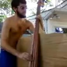 A bass made out of a plank.