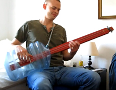 A bassguitar made out of a plastic bottle.