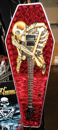 The body of this bass guitar is painted like a skeleton.