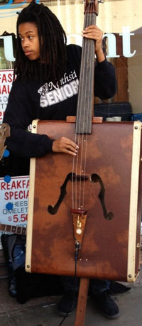 A bass made out of a suitcase.