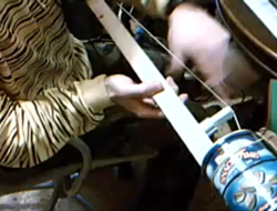 A bass made out of a tin can.